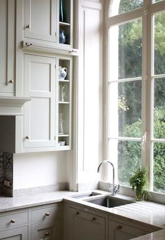 tall kitchen windows, always have windows go to countertop. This is such a wonderful look and fills your room with a vista!