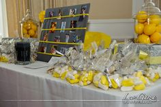 Yellow and Gray Baby Shower - photo board of mommy and daddy's baby pics, wrapped boxes