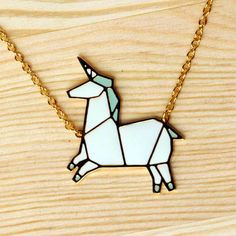 Origami unicorn necklace by Hug A Porcupine. http://www.hugaporcupine.com/collections/origami-necklaces/