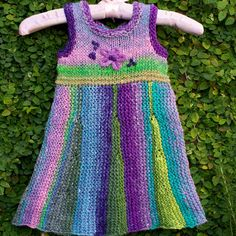 Hand knitted flared girl dress for 2-4 years of age, out of luxurious Noro Taiyo yarn (40% cotton, 30% silk, 15% wool, 15% nylon). Its great for summer