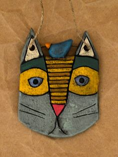 Ceramic kitty cat necklace with blue bird