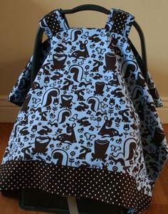 carseat cover tutorial (mostly need this for the dimensions)  EDIT: good tutorial, SUPER simple sewing project. great baby-shower gift (or gift to yourself, for your own baby)