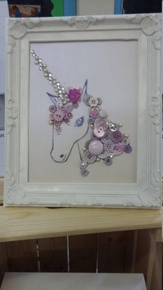 Unicorn art, made from different buttons,diamonte and other resin flowers. Each picture comes in a frame.