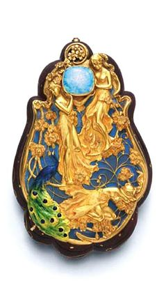 AN ART NOUVEAU OPAL, ENAMEL, GOLD AND HEARTWOOD BOX Designed as a sculpted purple heartwood box inlaid with gold wirework, with an opalescent plique-à-jour enamel lid decorated with three sculpted gold maidens, two of them holding a cabochon opal in their hands and a blue, green and yellow enamel peacock at their feet, with pastel enamel floral accents, pivoting open to reveal a compartment, mounted in 18k gold, circa 1900, with French assay marks