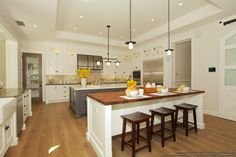 This gorgeous farmhouse kitchen featuring The Garrison Hardwood Flooring have all the equipment you need for a lavish dinner party or a quiet night alone.   Pin from thegarrisoncollection.com