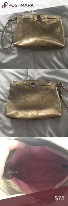 Great quality gold Coach wristlet Gold Coach wristlet with pink interior. Good quality. Coach Bags Clutches & Wristlets