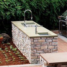 Durability and function drove the design. Stain- and acid-proof sealed concrete tops the two islands in the main prep and grilling zone. Deep stainless sinks by Kohler ease cleanup of large pots and serving dishes.