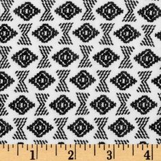 Stretch Rayon Jersey Knit Geometric Shapes Black/White from @fabricdotcom  This jersey knit fabric has an ultra soft hand, a fluid drape and about 25% stretch across the grain. This versatile fabric is perfect for creating stylish tops, tanks, lounge wear, gathered skirts and fuller dresses with a lining. Colors include