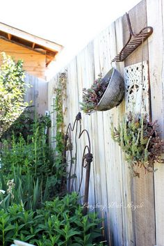 I may do this to our back fence!!  Add marbles, and make a new creation!