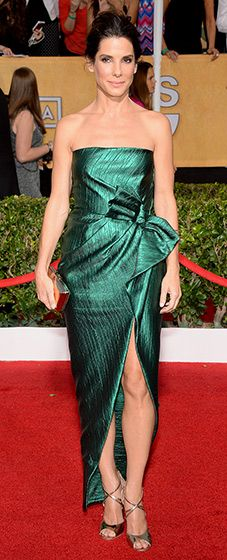 Sandra Bullock looking beautiful in a strapless, satin emerald green gown by Lanvin with a bow accent at her waist.