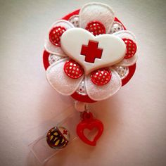 Padded Felt Flower with Medical Heart and Cross Retractable Id Badge Reel on Etsy, $15.50 #nurse #etsy #katieskreations #rn #heart #medical