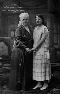 Princess Juliana with her grandmother Queen Emma. (personal note: I don't often see a photo showing such a stark contrast between the fashions of the younger generation (c. 20s) and the previous (Edwardian, Teens) generation (s). )