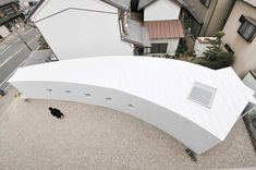Curved Little House / Studio Velocity