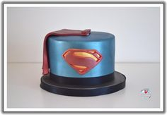 """Featuring the infamous superman logo, hand cut from fondant. Given the """"man of steel"""" treatment with metallic lustre paint. Superman Cakes, Superman Party, Superman Logo, Batman, 40th Birthday Cakes For Men, 40th Birthday Parties, Cake Decorating Classes, Cake Decorating Tutorials, Cake Design For Men"""
