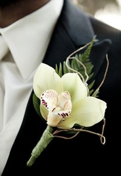 orchid and twig boutonniere