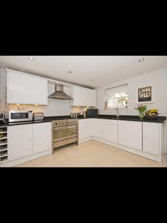 White cupboards with black worktop