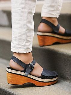 Magnolia Slope Clog | Leather clogs with delicately braided leather trim and buckle ankle closure.  Wooden sloped platform.   *By Free People  *Modern and sartorial styles, artisan crafted from fine leathers and premium materials, FP Collection shoes are coveted for their signature cutting-edge aesthetic.