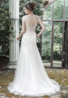 """Maggie Sottero """"Sundance"""" ~ Make a statement in this glamorous A-line wedding dress comprised of a Vogue satin slip dress and lovely tulle overlay with dramatic illusion back and illusion bateau neckline, adorned with glimmering metallic lace appliqués. Finished with covered buttons over zipper closure."""