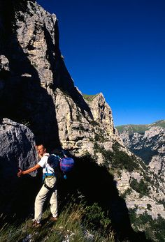 Hiking ~ the wilder Monti Sibilini have more difficult access, many ancient legends about them and some seldom done rock and ice climbing. Here Enrico Bernieri traversing a long ledge to reach a route.
