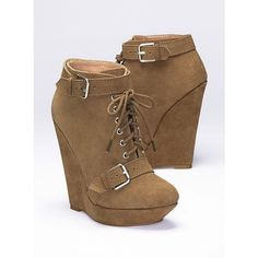 Runway style takes to the streets with this urban-chic wedge Bootie. Buckles at the ankle, toe and heel add an edgy element to soft Suede. Front laces make thi…