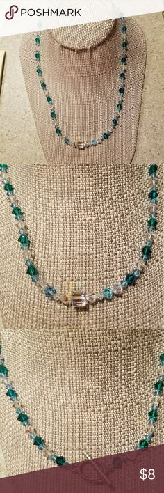 Handmade Swarovski crystals necklace New, never worn. Beautiful sparkling crystals in clear, turquoise & light blue. 18in long. Jewelry Necklaces