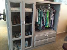 Re-purposed entertainment center turned kids storage closet.