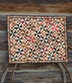 """""""Windy Sister"""" is a scrappy project made of many Civil War–era prints. Anything goes in this make-do quilt!"""
