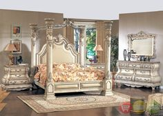 Caledonian Victorian Inspired Canopy Bedroom Set in Antique White. Extravagant and grandiose, the Caledonian Collection in Whitewash is distinguished by its traditional look, elaborate resin carvings, and curvy structures. With solid hardwoods and wood veneers construction, the Calidonian Collection's four-poster canopy bed, nightstand, dresser, and mirror will bring years of pure elegance and sophistication to your bedroom.