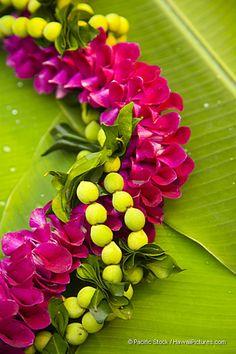 Orchid lei on banana leaf. Beautiful