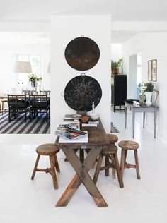 lovely pure white resin floor as a canvas to  reclaimed timber furniture.. so modern chic