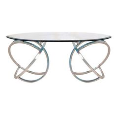 @Overstock - Curved Coffee Table - Featuring a unique curved shining stainless steel frame, this coffee table is sure to show off your impeccable taste. With a tempered and beveled glass top, you'll love the contemporary style.  http://www.overstock.com/Home-Garden/Curved-Coffee-Table/9139753/product.html?CID=214117 $463.49