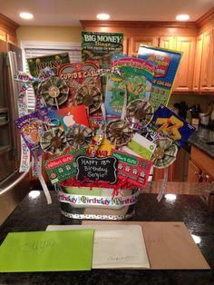 Lottery tickets, money and gift cards! My son loved it! Lottery tickets, money and gift cards! My son loved it! Themed Gift Baskets, Birthday Gift Baskets, Diy Gift Baskets, 18th Birthday Gifts For Boys, 70th Birthday, Birthday Presents, Fundraiser Baskets, Raffle Baskets, Lottery Ticket Tree