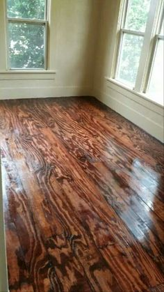 This DIY Floor Project was made from Plywood, we took 13 full sheets of Plywood and ripped the into 6 in wide and 8 ft long Planks, then glues down with also some finishing nails, Stained and Polyurethaned, Total square footage was 400, Total Cost of this Project was 300.00 and we did a Living Room, Bedroom and Hallway, , Now that's a $$$$$ Saving Project. ..  https://www.facebook.com/pages/Trash-To-Treasures/261463607265438?ref_type=bookmark
