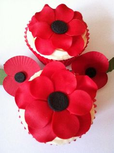 lemon cupcakes, by Cutie Cupcakes, UK. Red Poppies to remember fallen veterans, on 11/11/11.