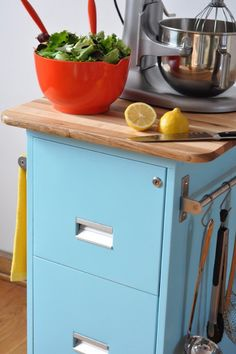 Make a Rolling Kitchen Cart from an old filing Cabinet:  Secondhand filing cabinet  Spray metal primer  2 cans spray paint  Two rolling casters and two locking casters  A cutting board or piece of butcher block that's at least the size of the top of your filing cabinet  Two inexpensive horizontal towel racks - Click image to find more Home Decor Pinterest pins