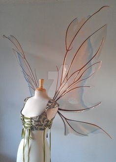 My Kira wing design made into a much larger size. These were for Gina's wedding and she wanted soft ivory and camel colors with a bit of blue. Since there is no real way to get an ivory color with ...