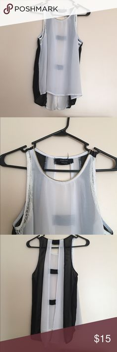 Buckles Paper Tee Black White Gold Top The accents on this shirt are so cute . Black and white sheer shirt with gold detailing around neck and open back . I bought this from Buckle and wore it one time . 60% cotton 40 % polyester Buckle Tops Blouses