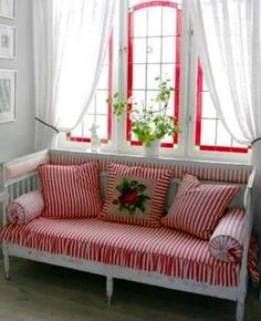Sitting area - Charming red and white stripe - it's the details ...the red around the white windows with white curtains
