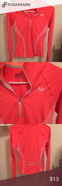 Athletic long sleeve A&F top A&F peachy pink long sleeve athletic work out top. It is a half zip and has a zipper pocket on the backside. There are parts for your hands to stick through on each arm. Worn only a few times and in new condition. Slim fitting and a collar at the top. Abercrombie & Fitch Tops Sweatshirts & Hoodies