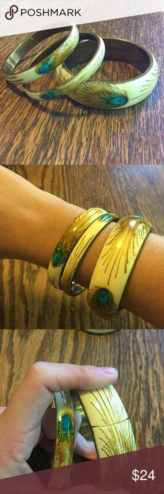 J. Crew Peacock Bangle Set J. Crew Peacock Bangle Set. One large Bangle and 2 smaller bangles. 2 of the bangles have small splits in them but the inner frame is completely in tact and sturdy. You really don't even notice the cracks when they are on. Gold accents. Great accessory to add to any outfit to just add a pop of color! J. Crew Jewelry Bracelets