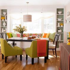 Green, yellow and pops of red make a pretty nature-inspired color scheme for this cheery dining area. See more color ideas: http://www.bhg.com/decorating/color/colors/decorating-with-color-expert-tips/?socsrc=bhgpin022713greenwindowseat=8