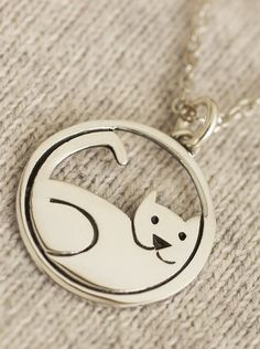 Show the world what you already know -- that your cherished kitty is the center of your world with our playful sterling necklace made by artisans in Mexico.