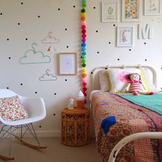 Cloud hangers and dotted walls. #kids #decor