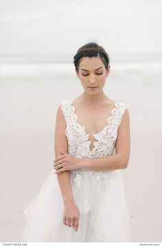Although crafted with dreamy lace and tulle, this gown boasts a deep V-neckline that adds a touch of sensuality. Flowy Gown, Winter Wedding Inspiration, I Got Married, Something Blue, Designer Wedding Dresses, Floral Design, Tulle, Wedding Photography, Gowns