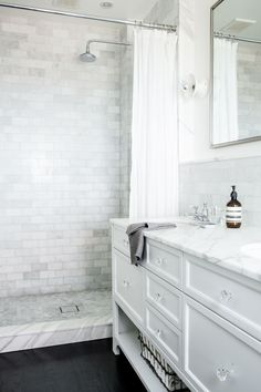 Walk-in standing shower without glass wall or door. Walk-in shower with shower curtain. It can be done without looking crummy! Splendor in the Bath. White cabinets and marble.