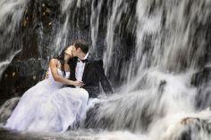 kiss under a waterfall