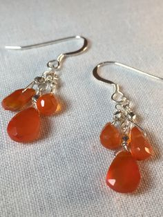 Earrings of Golden-Orange Carnelian Drops set on Sterling Chain and Sterling French Earwires by CasaDeCastiza on Etsy https://www.etsy.com/listing/237576389/earrings-of-golden-orange-carnelian