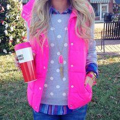 Pink puffer vest, plaid shirt, polka dot sweater