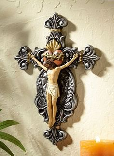 Exquisite Jesus Sacred Heart Wall Crucifix. This cross is so beautiful in person. There is great attention to detail while hand painted. Church, chapel, prayer room or home devotional. Measures 7 x 10