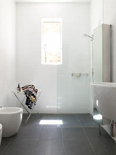 Bathroom gray floor white walls big white wall tiles big grey floor tiles i like the . White Wall Tiles, Grey Floor Tiles, White Bathroom Tiles, Bathroom Floor Tiles, Grey Flooring, Grey Bathrooms, Laundry In Bathroom, Bathroom Cleaning, Small Bathroom